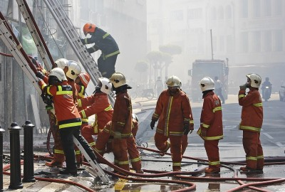 A group of firefighters at work.