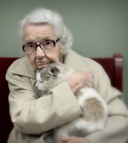 A senior citizen with her cat.
